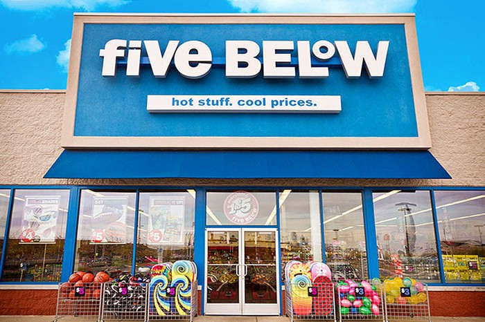 "Entrance of a Five Below store with its logo, ""Hot stuff. Cool prices."""