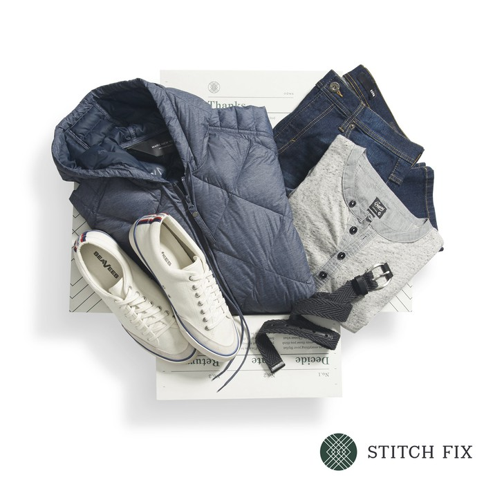 A Stitch Fix box of five menswear items: shoes, belt, jacket, shirt, and pants