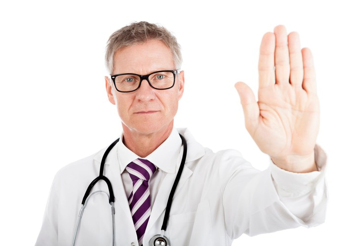 "Doctor holding up hand as if to say ""Stop."""