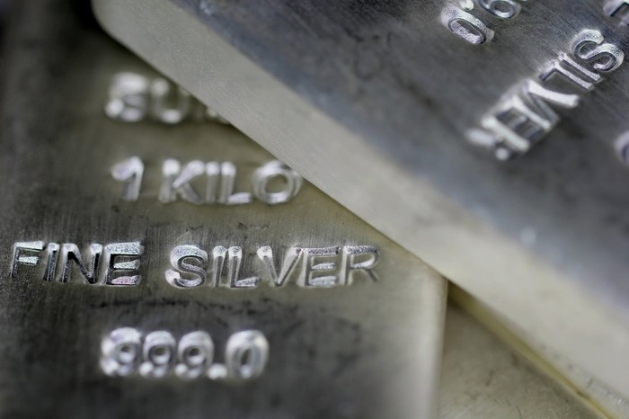 Silver bars lie on top of each other.