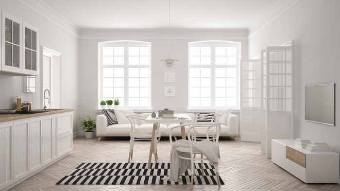 A minimalist furnished apartment in white with black accents
