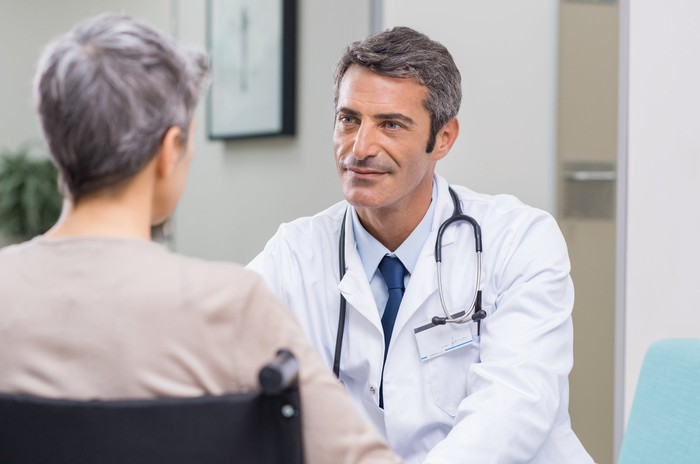 Doctor sitting across from older patient
