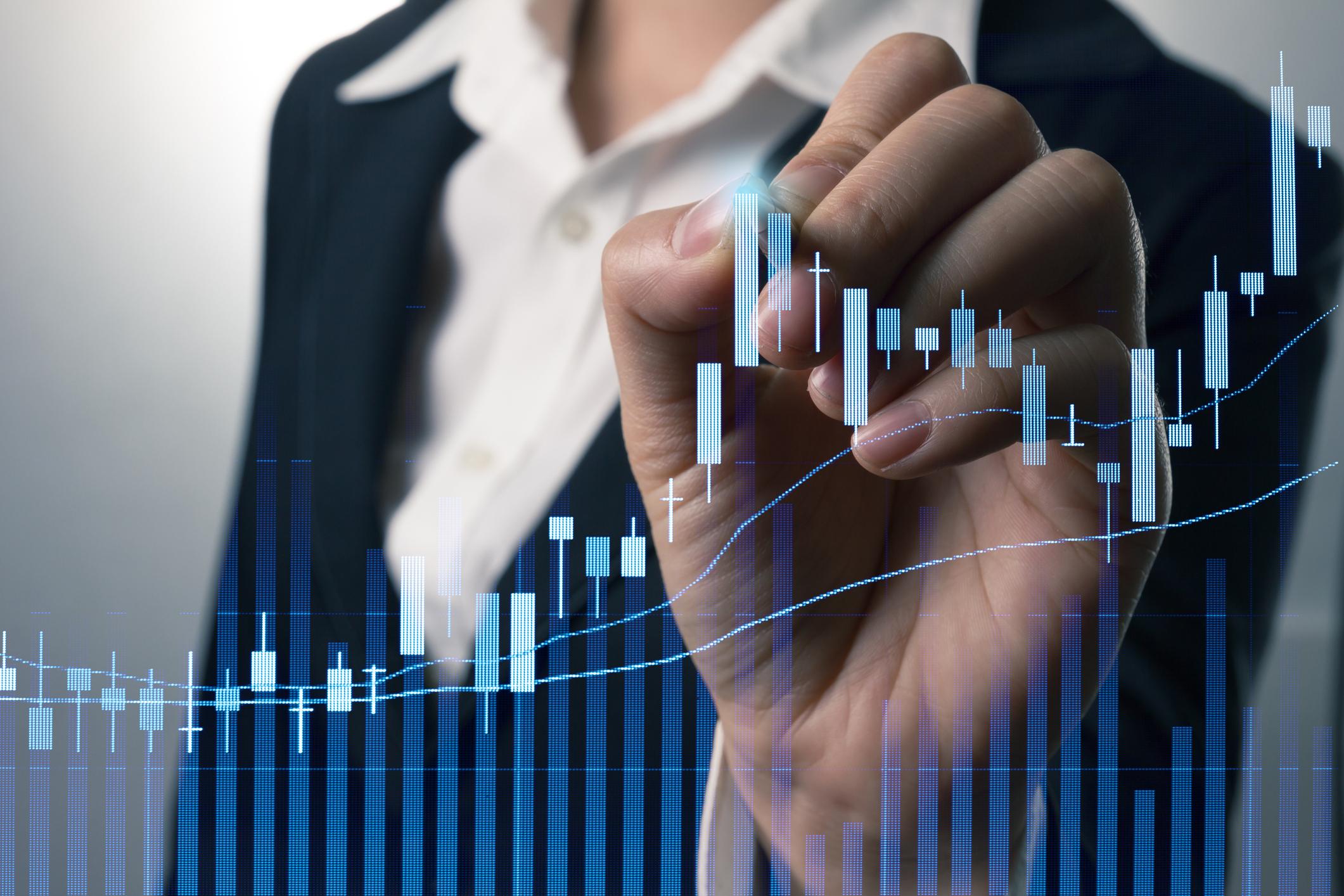 Person seemingly drawing rising stock bar chart.