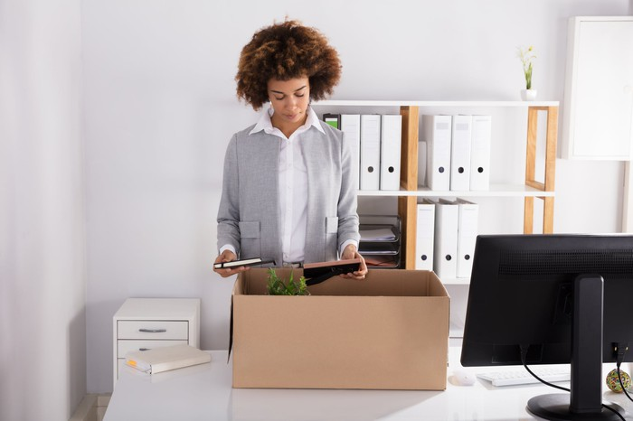 Woman packing up a desk