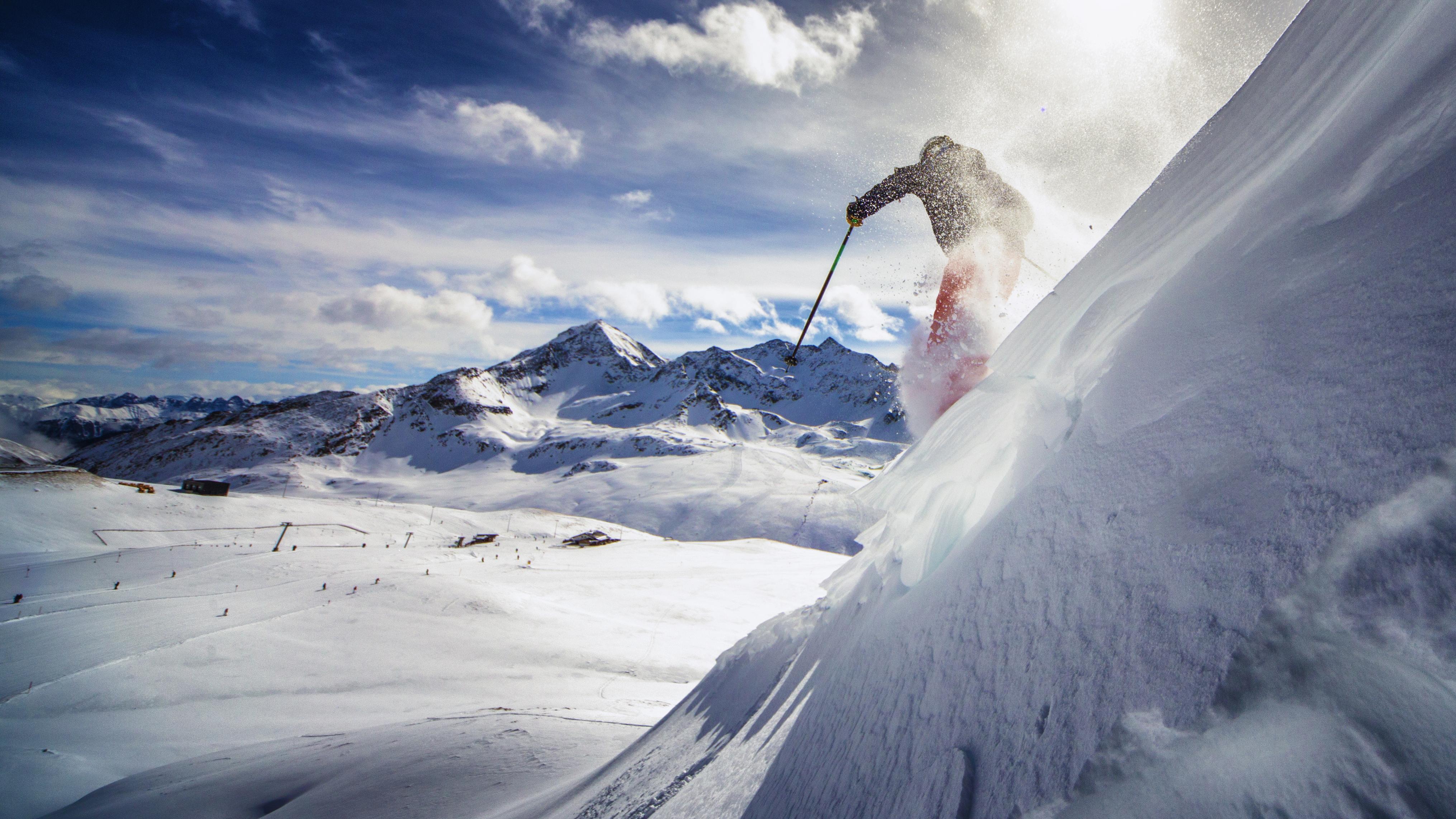 Skier skiing down a mountain.