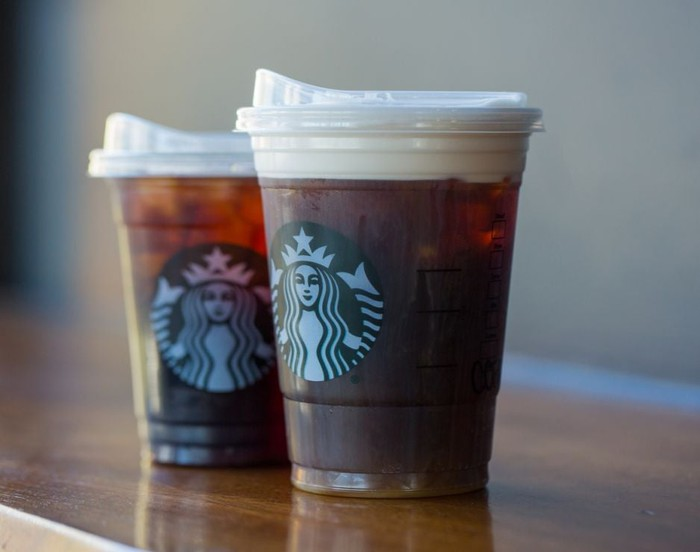 Two Starbucks' cold coffee drinks with strawless lids.