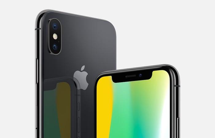 Two iPhone X smartphones.
