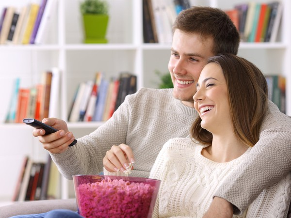 AG smiling couple watching TV