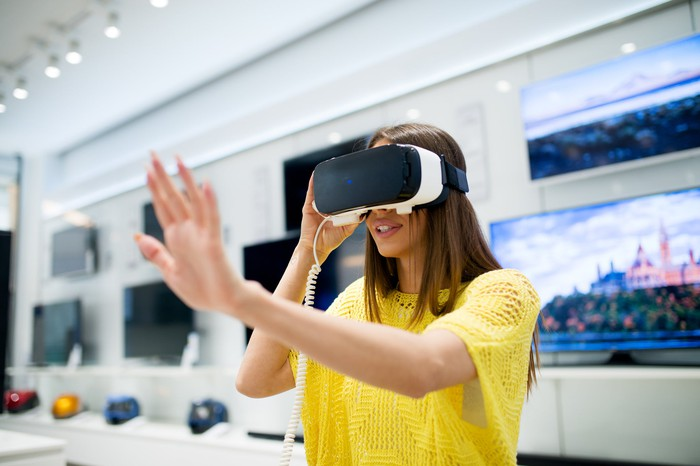 A woman uses a virtual reality headset.