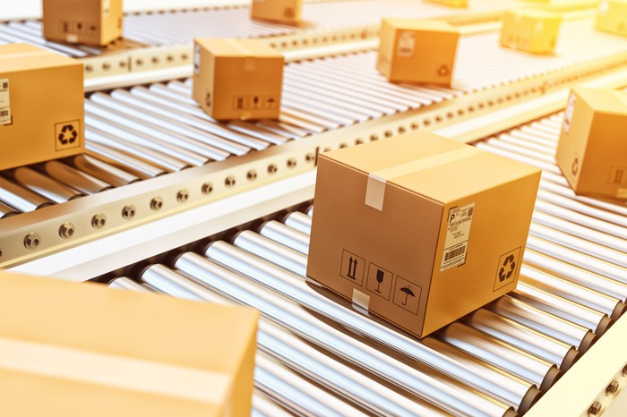 Sealed shipping cartons being sorted in a warehouse