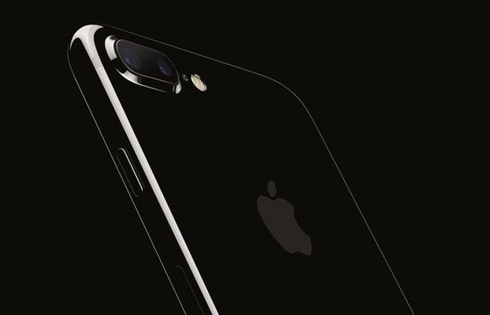 Apple's iPhone 7 Plus in jet black against a black background.
