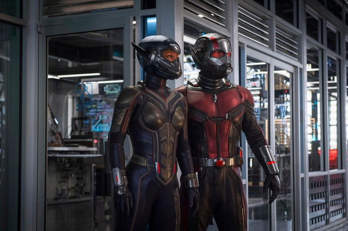 Scene from Ant-Man and the Wasp, with the titular heroes in their respective costumes in front of a secured, metal and heavy glass room filled with computer equipment.