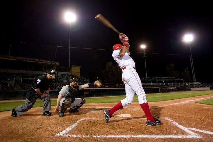 A baseball batter swinging a bat.