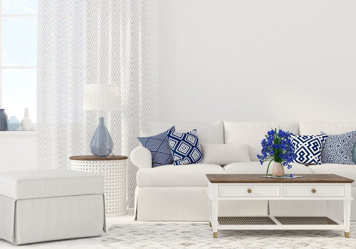 A livingroom set including a couch, side table, and coffee table.