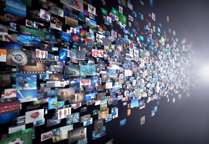 Cloud computing concept: wall of computer-generated images stretching to infinity.