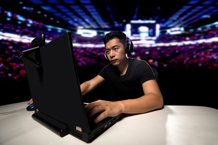 Man playing video games in a stadium.