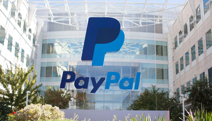A PayPal building with the PayPal logo on a sign in front of it.