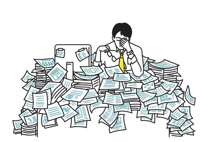 Vector illustration of very tired and exhausted businessman, sitting at his table, flood with working paper sheet,