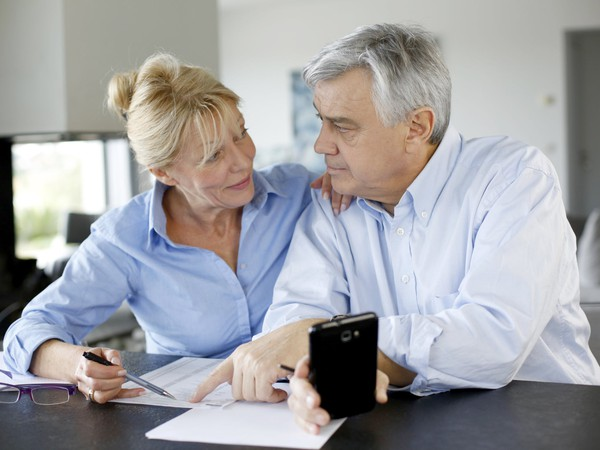 couple at table looking at paperwork