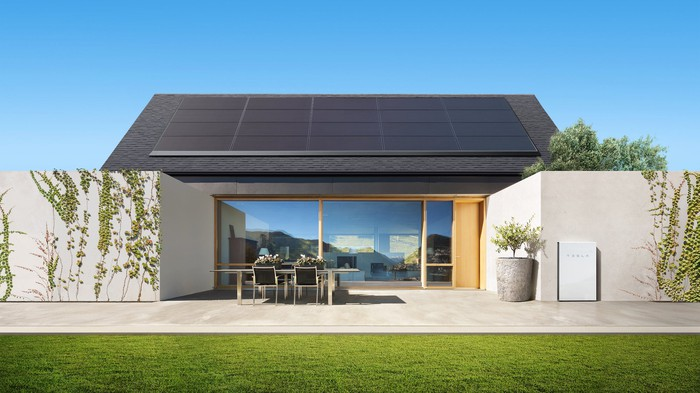 A house equipped with Tesla solar panels and a Powerwall