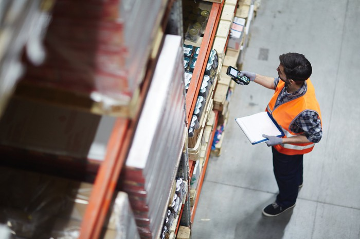 Worker managing warehouse inventory.