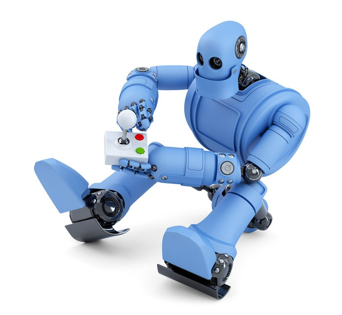 A blue robot holding a video game controller