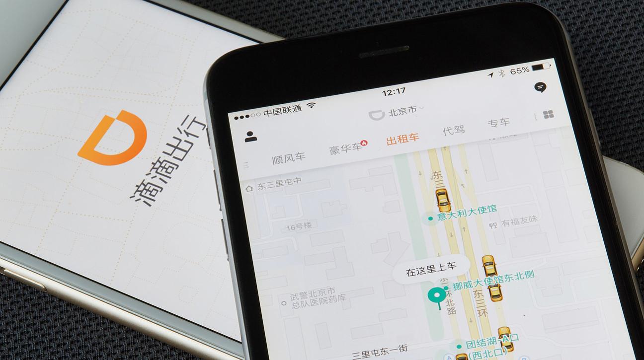 Didi's app is shown running on two smartphones.
