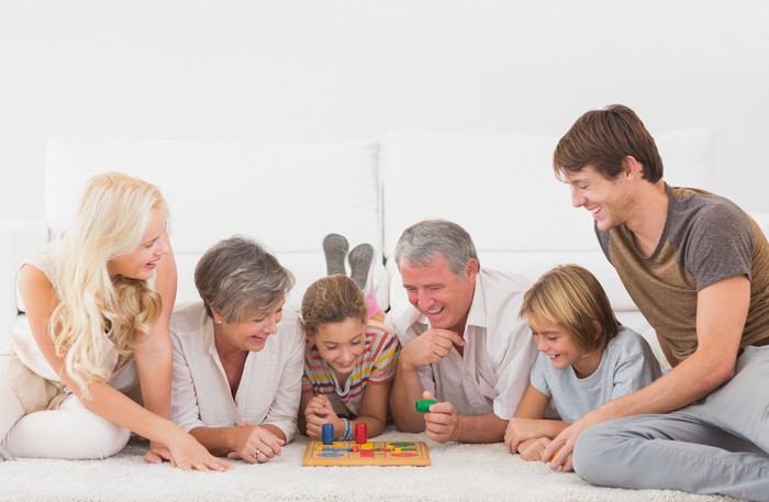 A family plays a board game.