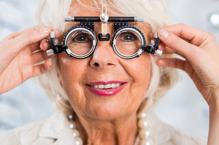A senior woman getting her eyes checked.