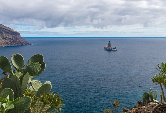 Offshore drilling rig on the water.