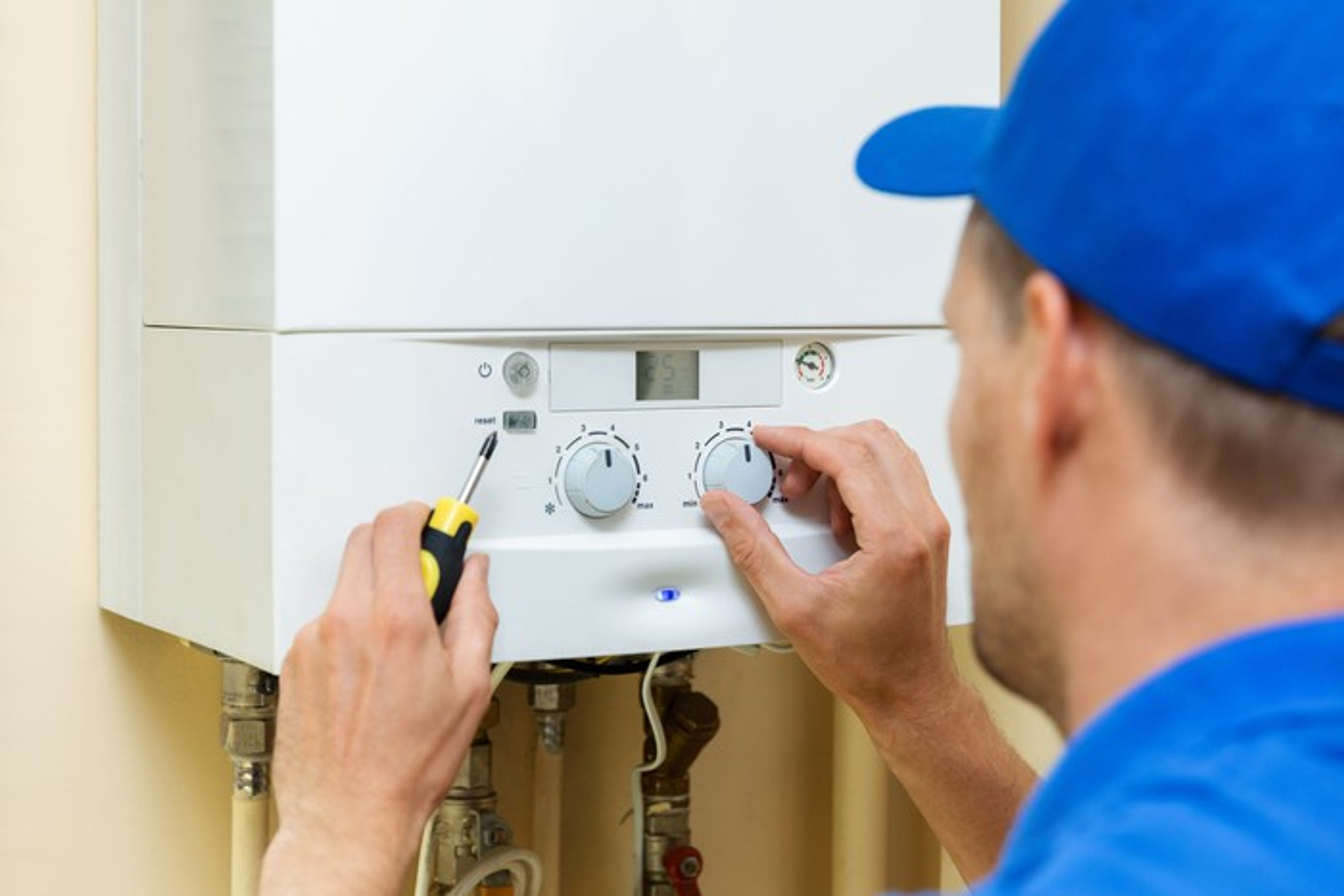 Mechanic installing water heater