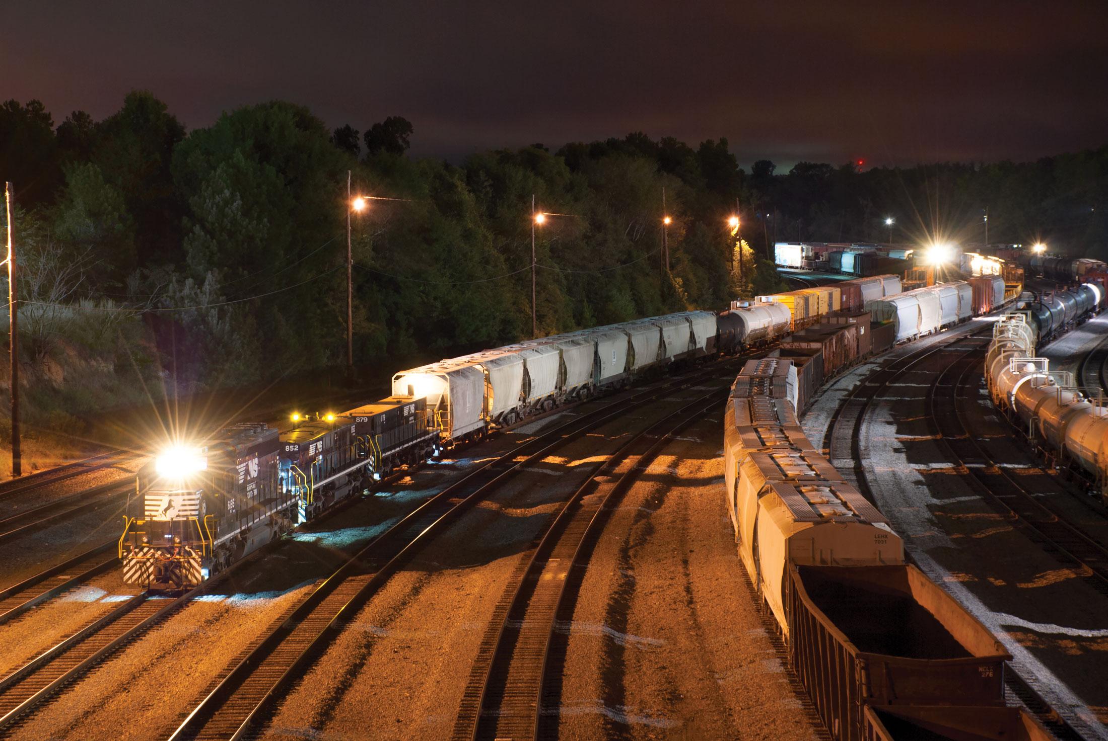 Rail yard at night.