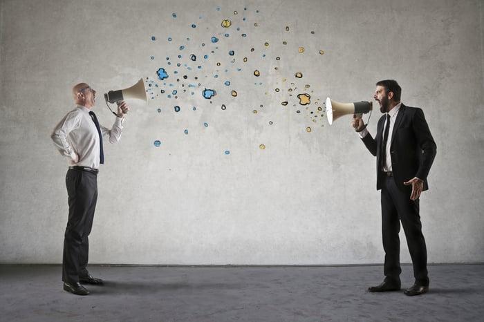 Men are screaming into megaphones