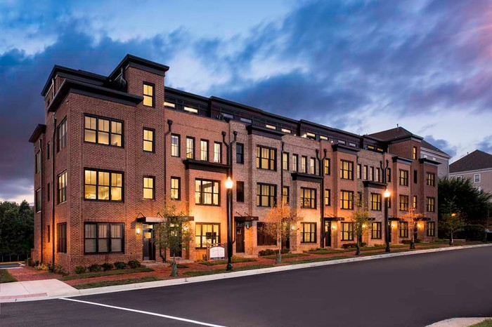 Townhome row at night.