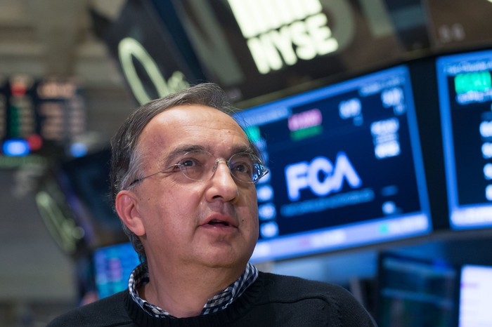 Marchionne is pictured in his trademark sweater, on the floor of the New York Stock Exchange.