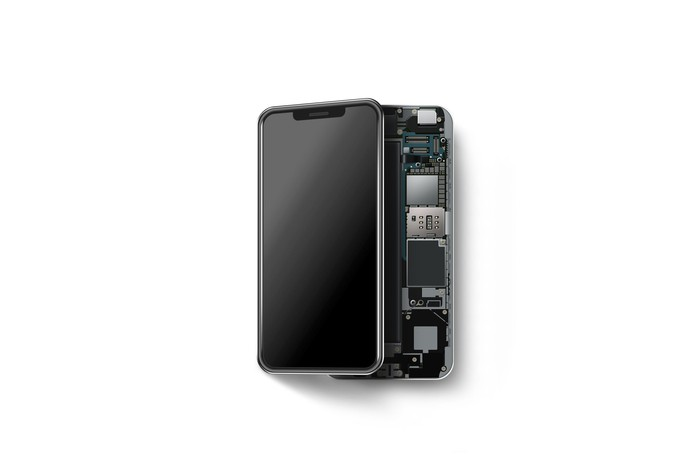 Modern smartphone, cracked open with the screen moved to the side and showing some components inside the shell.