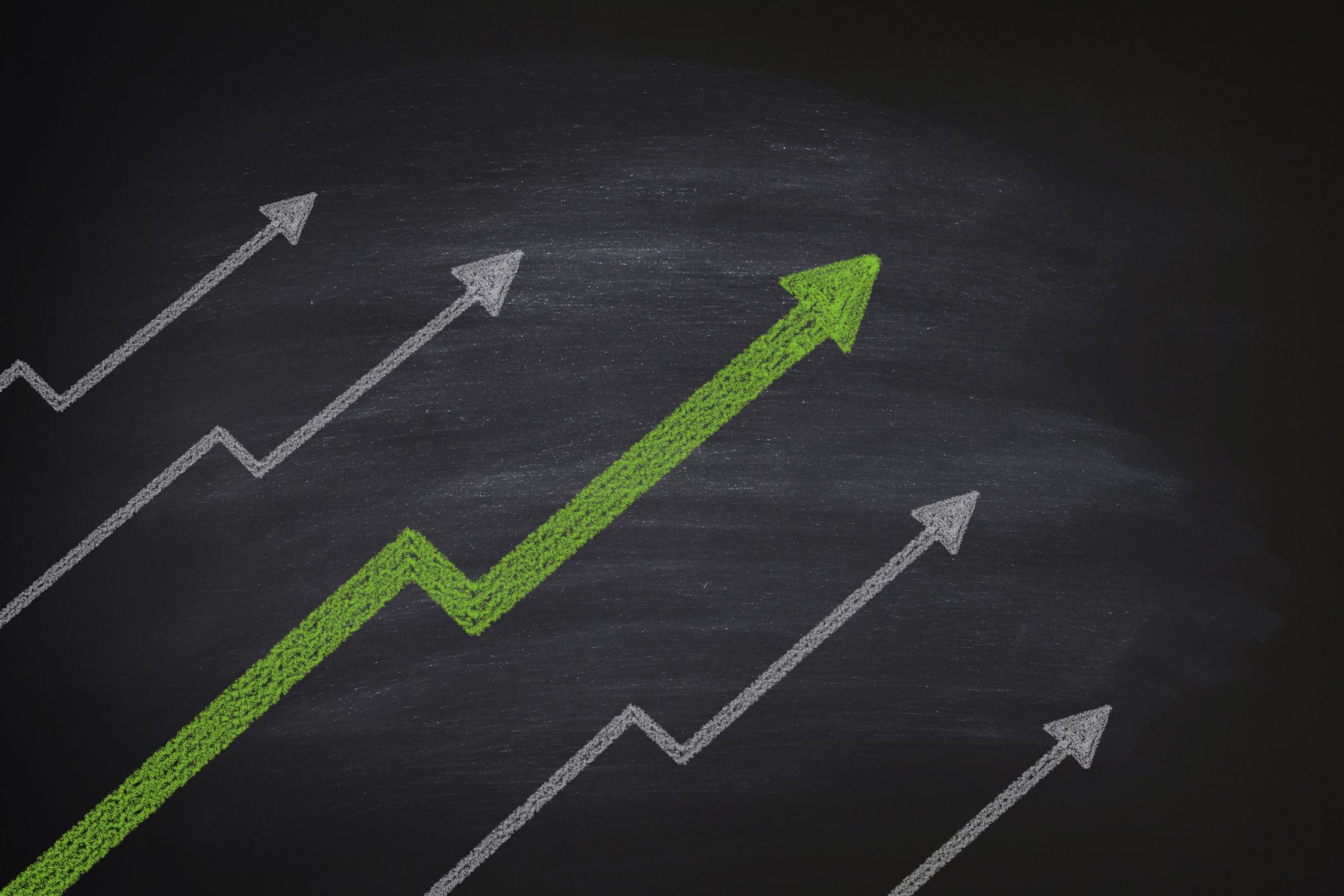Stock market gains on a blackboard