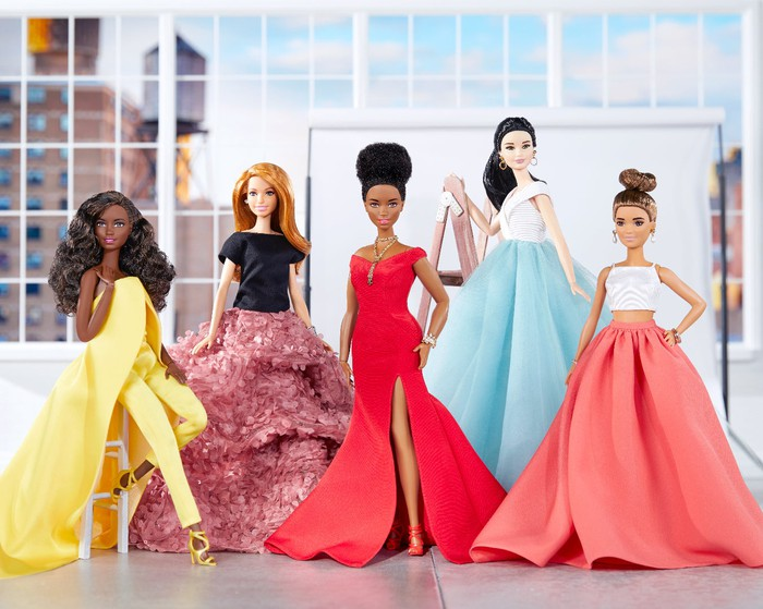 A variety of Barbie dolls dressed in outfits created by fashion designer Christian Siriano.
