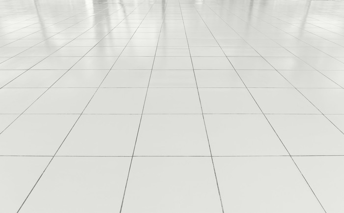 White floor made up of square tiles.