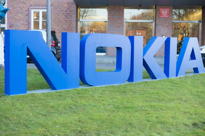 Nokia's company logo in the form of large, blue letters on the lawn in front of company headquarters in Espoo, Finland.
