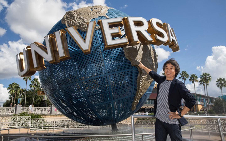 Nintendo exec in front of the Universal Orlando globe.