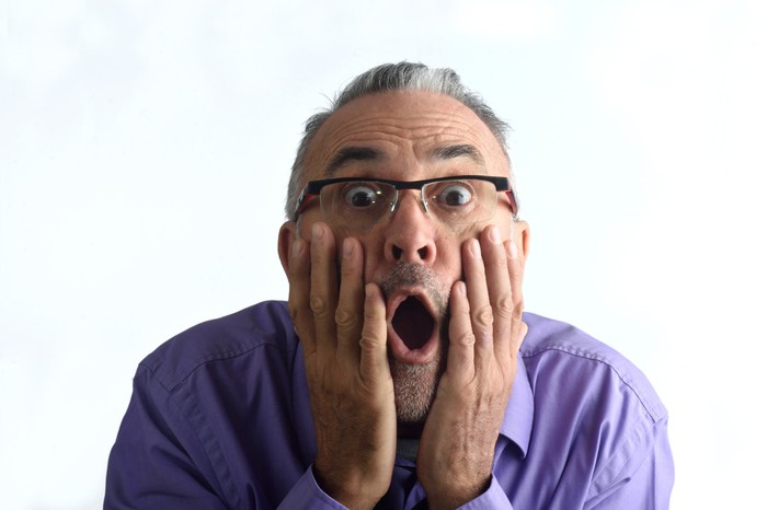 surprised man with mouth open and palms on cheeks