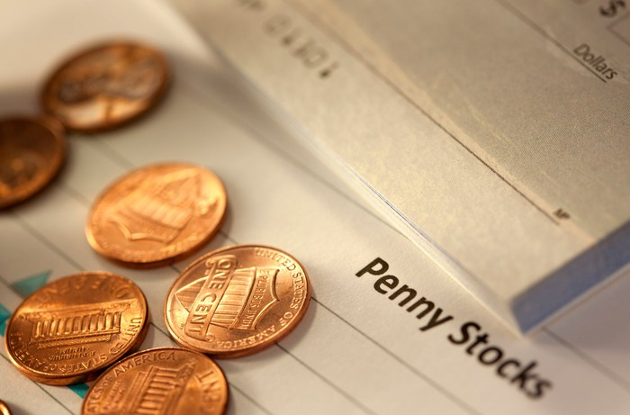 Pennies resting on a sheet of paper labeled Penny Stocks.