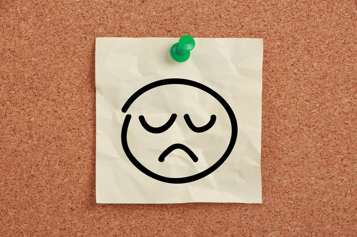 Drawing of sad face pinned to board