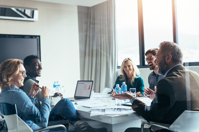 People in a conference room, collaborating at a business meeting