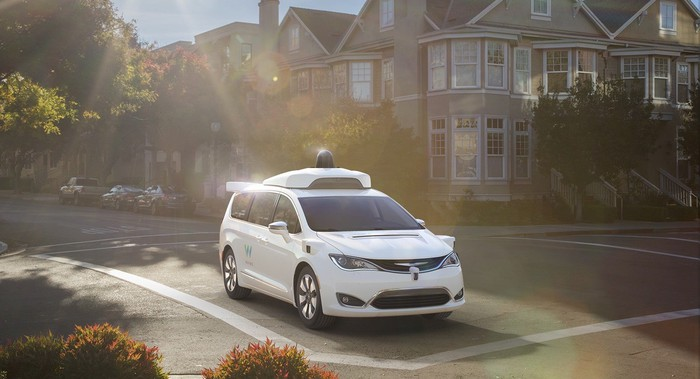 Image of Waymo minivan on street.