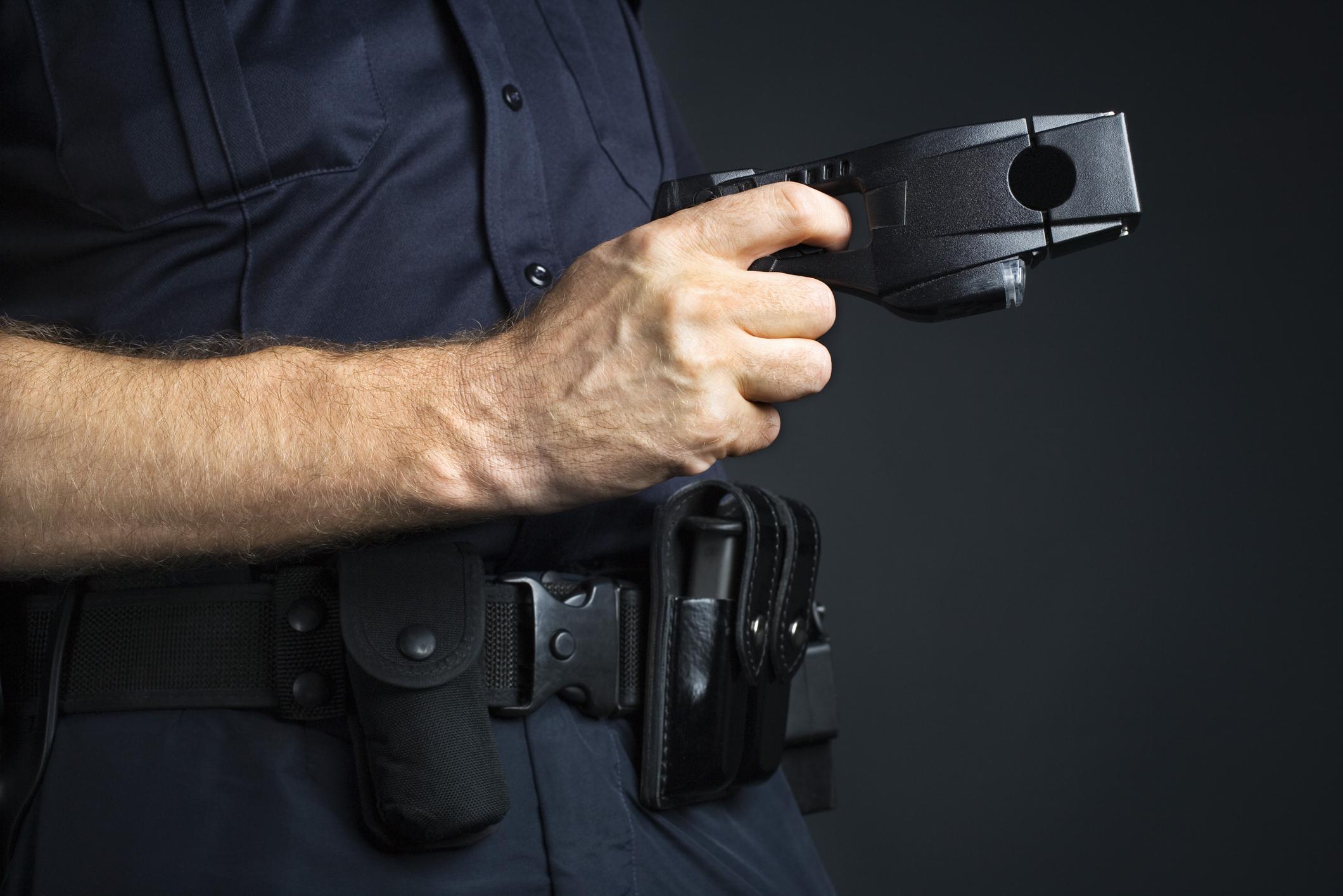 An officer holding a taser.