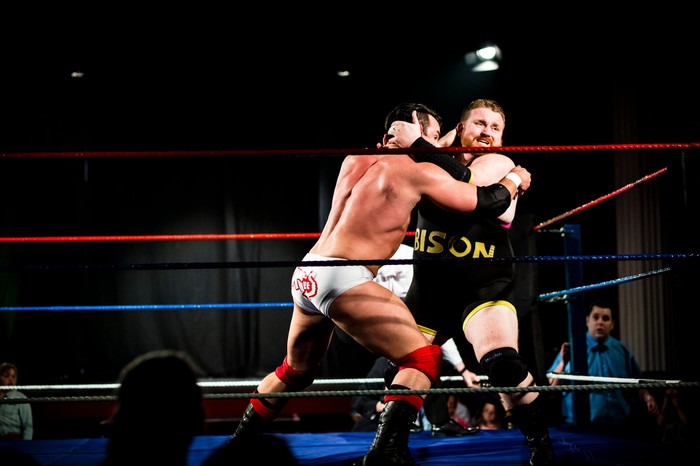 Two wrestlers fighting in the ring
