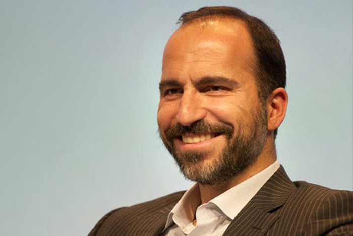 An official photo of Khosrowshahi. He's seated, smiling, wearing a jacket with no tie.
