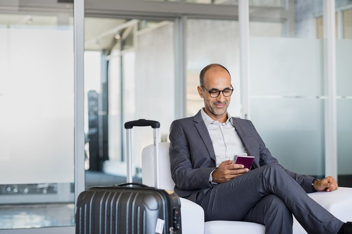 Man seated in airport lounge.